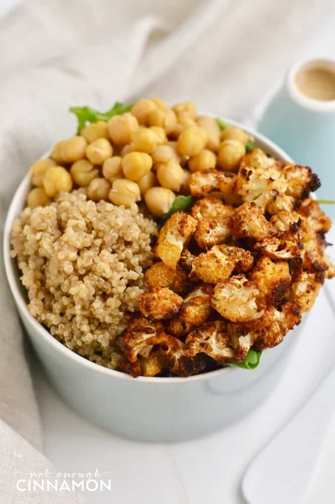 Quinoa Bowl with Roasted Cauliflower and Tahini Dressing #vegan #lunch #dinner #healthy #cleaneating - Click to see the recipe on NotEnoughCinnamon.com