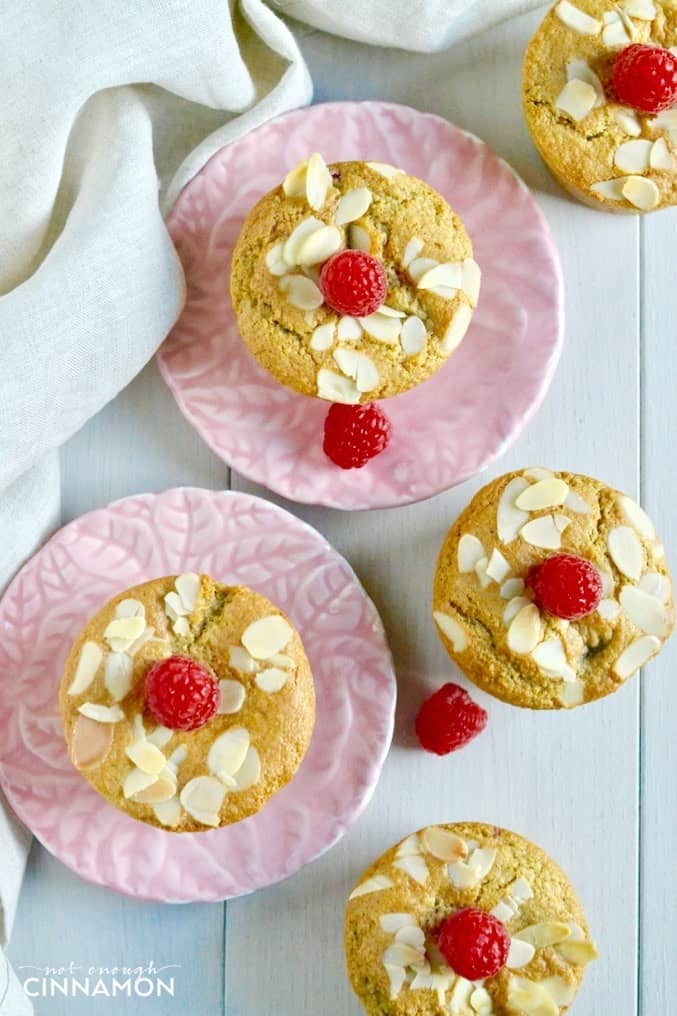 overhead shot of healthy raspberry almond muffins on small pink plates