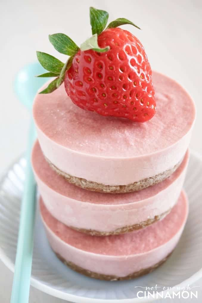 side view of a stack of No Bake Vegan Strawberry Mini Cheesecakes