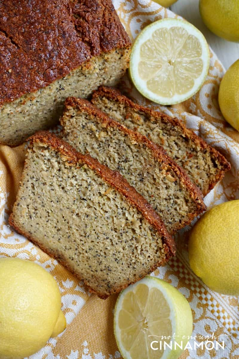 a moist paleo zucchini bread with lemon and poppy seeds cut into slices