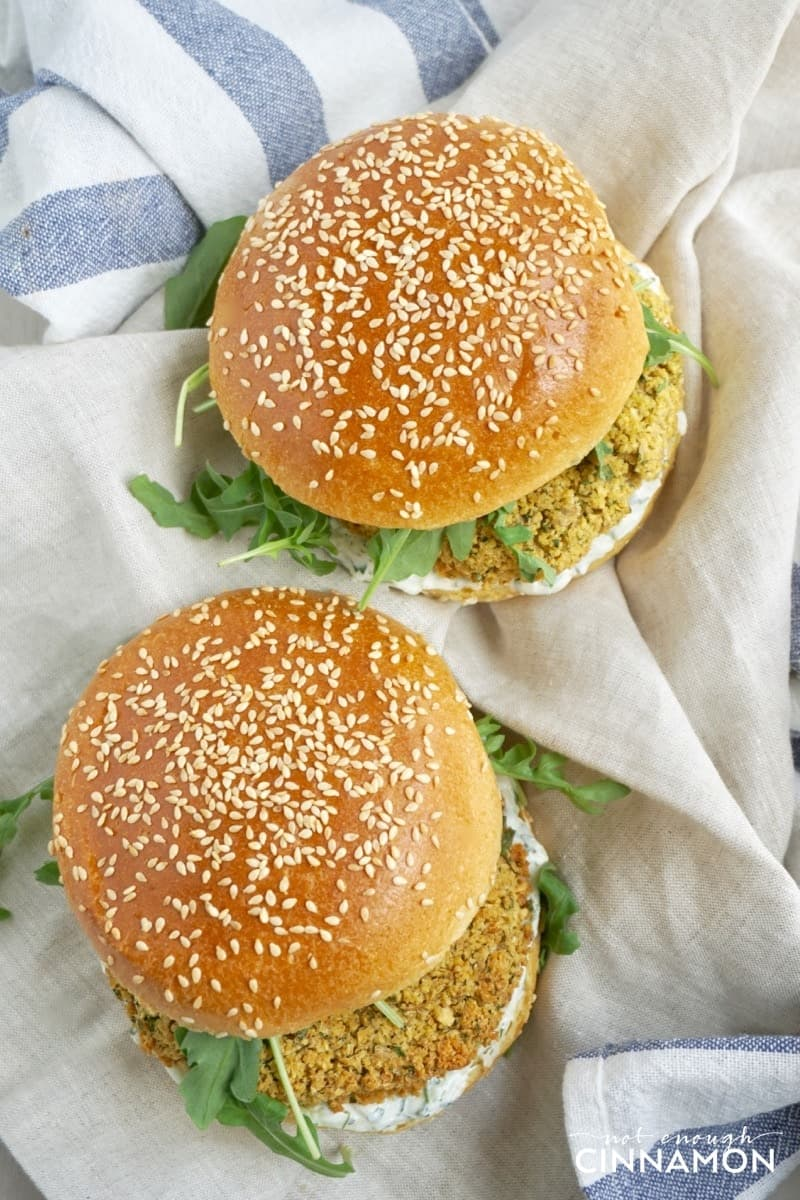 overhead shot of two vegetarian falafel burgers with falafel patties and arugula