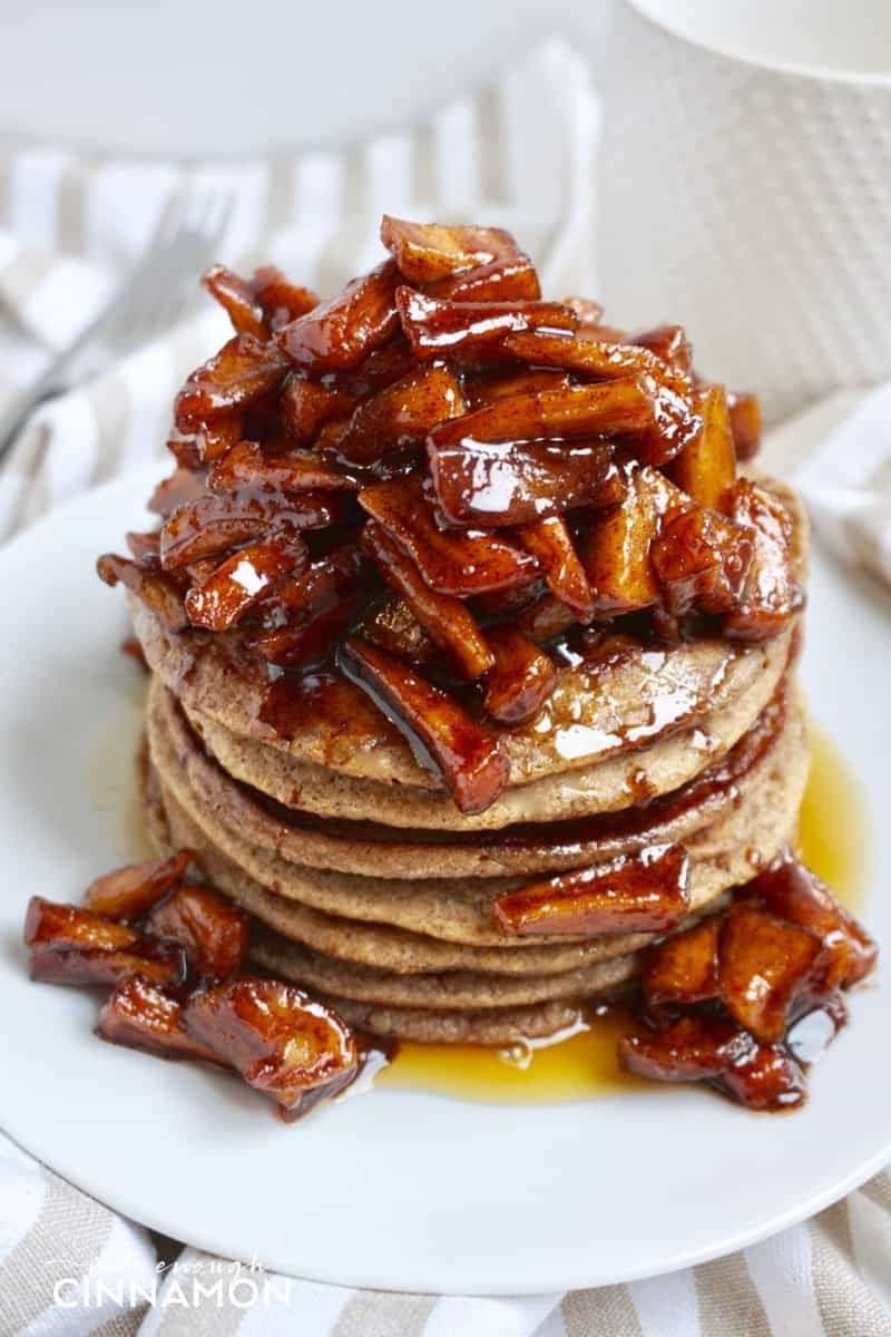 a stack of gluten-free apple cinnamon pancakes topped with sauteed cinnamon apples