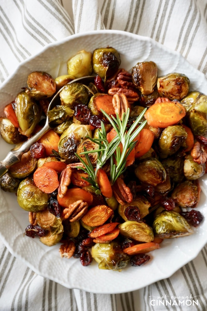 overhead shot of maple roasted vegetables with balsamic vinegar, rosemary and pecans