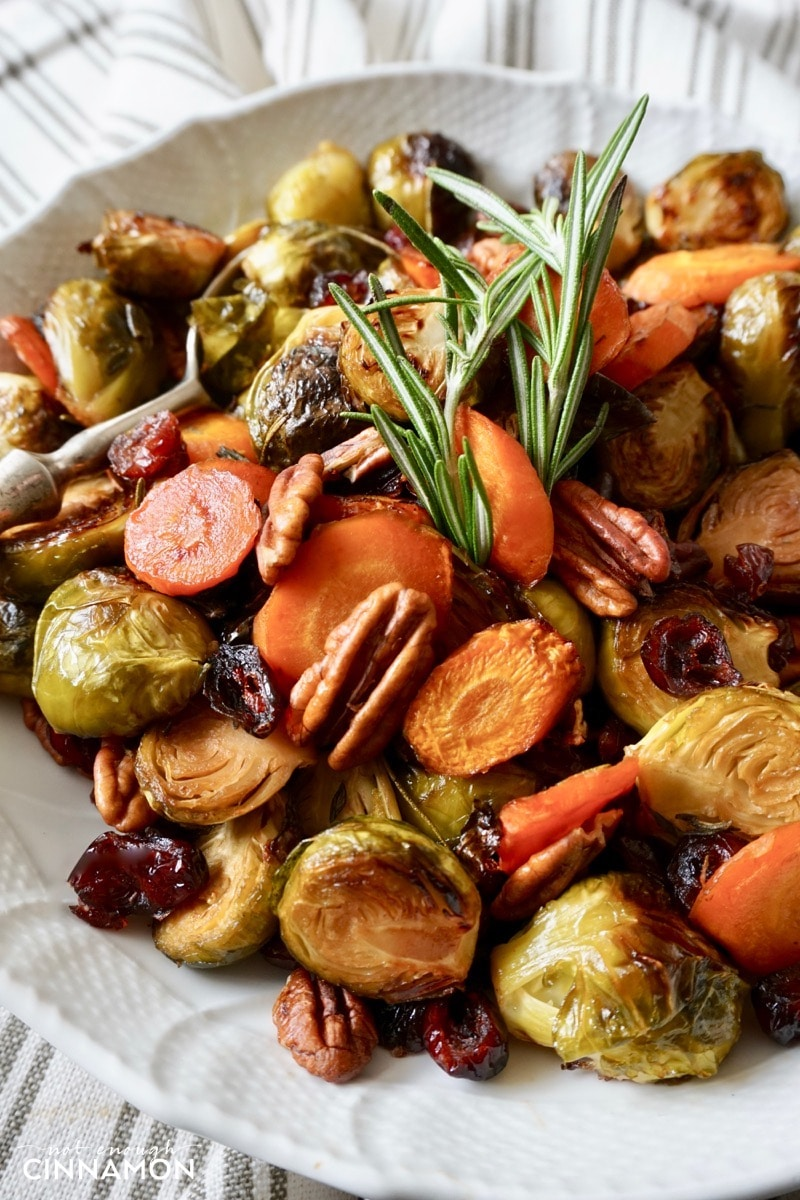 close-up of a plate with balsamic and maple roasted Brussels sprouts and carrots with pecans