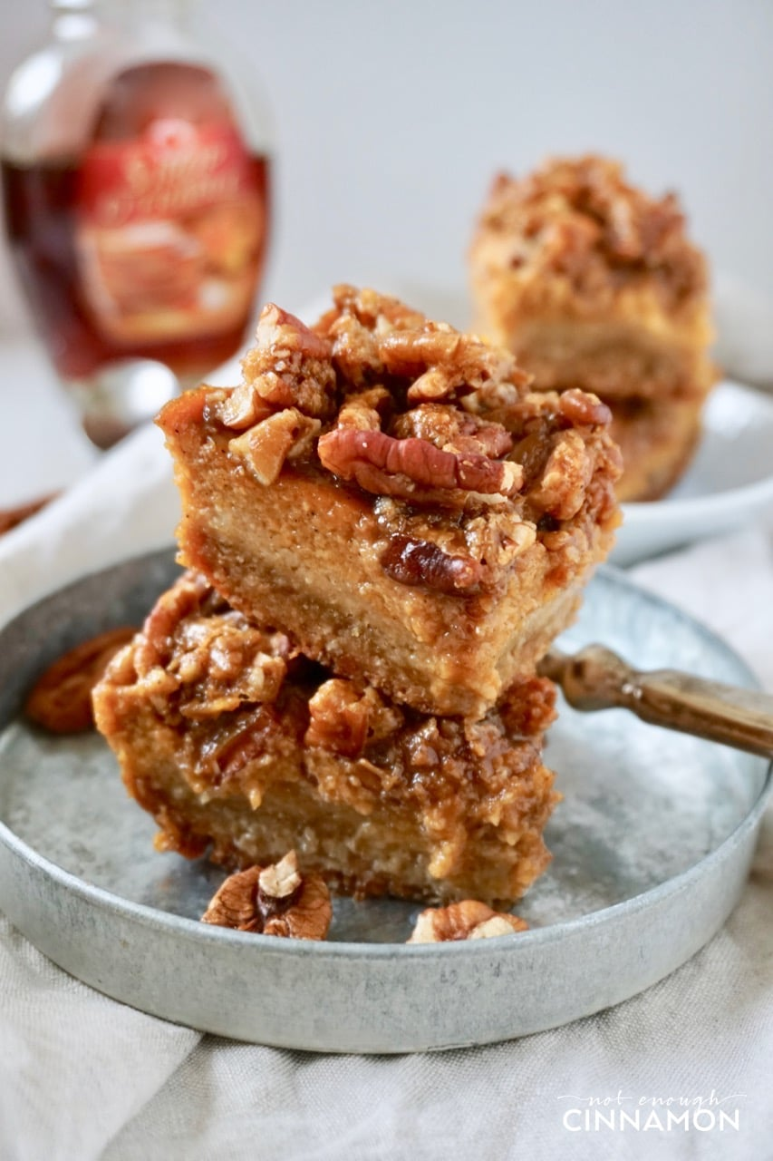 side view of Healthy Pumpkin Pecan Bars stacked on a small metal plate