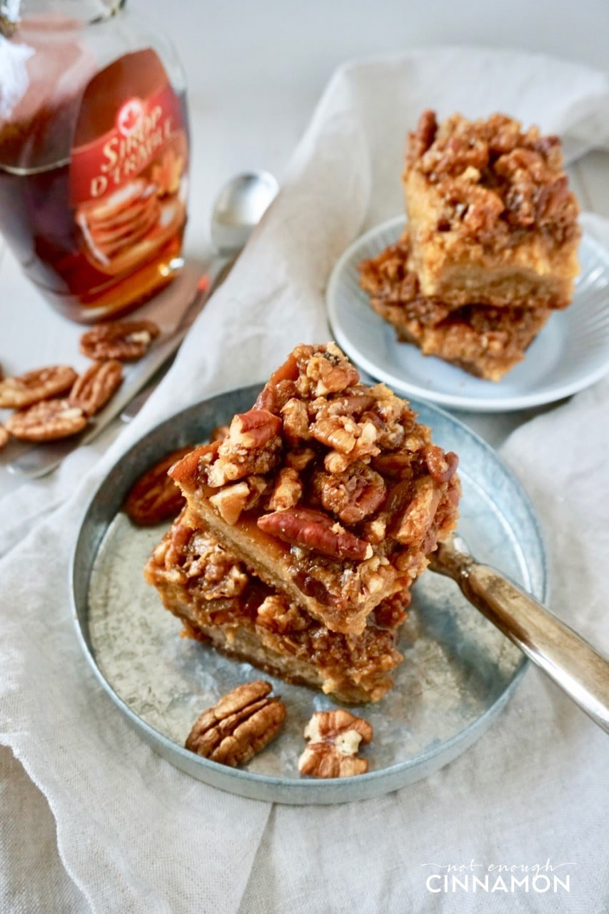 overhead shot of a stack of Healthy Pumpkin Pecan Bars on a metal plate