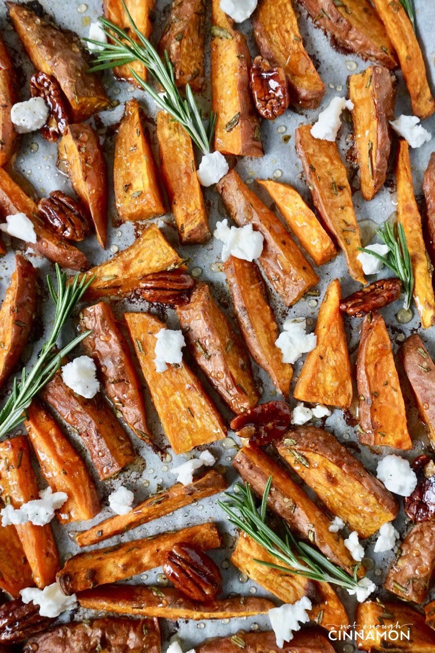 baked Sweet potato wedges drizzled with extra virgin olive oil and served with goat cheese and candied pecans