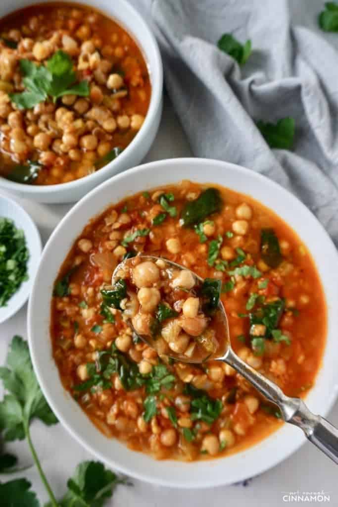 A chickpea soup spiced with cumin, paprika and cinnamon. Super delicious, filling and perfect for winter! #vegan #glutenfree Recipe on NotEnoughCinnamon.com