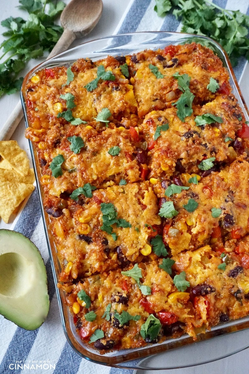 overhead shot of Mexican quinoa casserole in a glass dish sprinkled with cilantro leaves