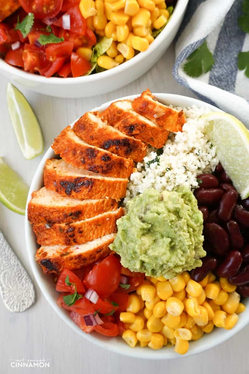 overhead shot of Chipotle's Chicken Burrito Bowl with Cilantro Lime Cauliflower Rice, guacamole, black beans and corn