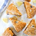 paleo gluten-free lemon blueberry scones on a white tabletop