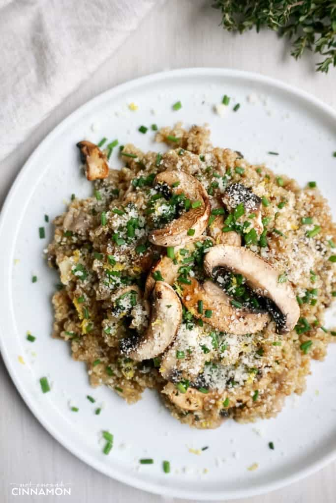 overhead shot of a plate of Mushroom Quinoa Risotto sprinkled with chives