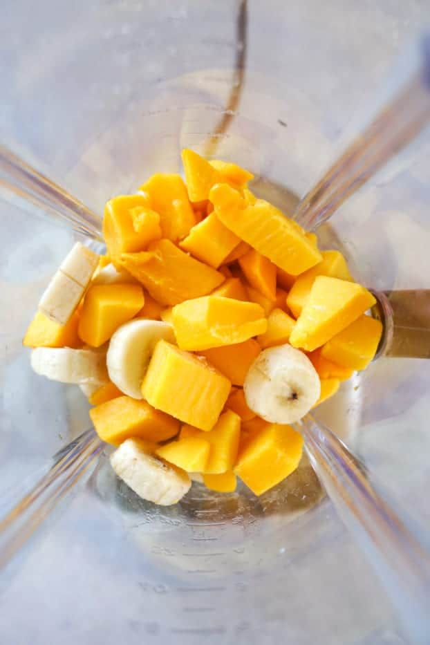 Frozen banana and mango in a blender