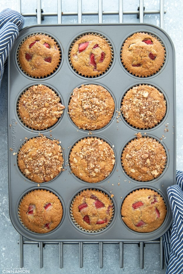 Healthy strawberry muffins in a muffin tin right out of the oven