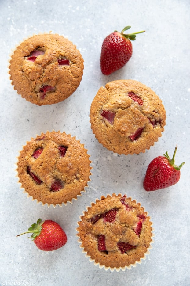Overhead shot of four strawberry muffins