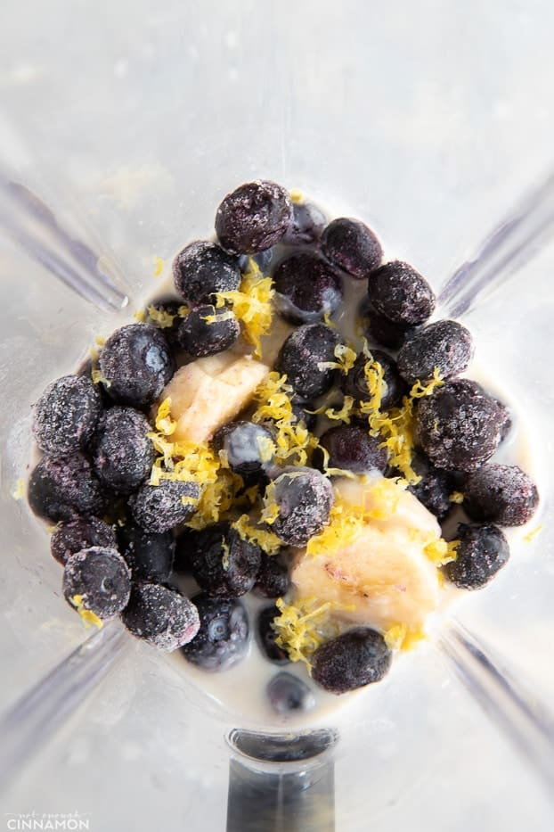 Frozen blueberries, banana and lemon zest in a blender