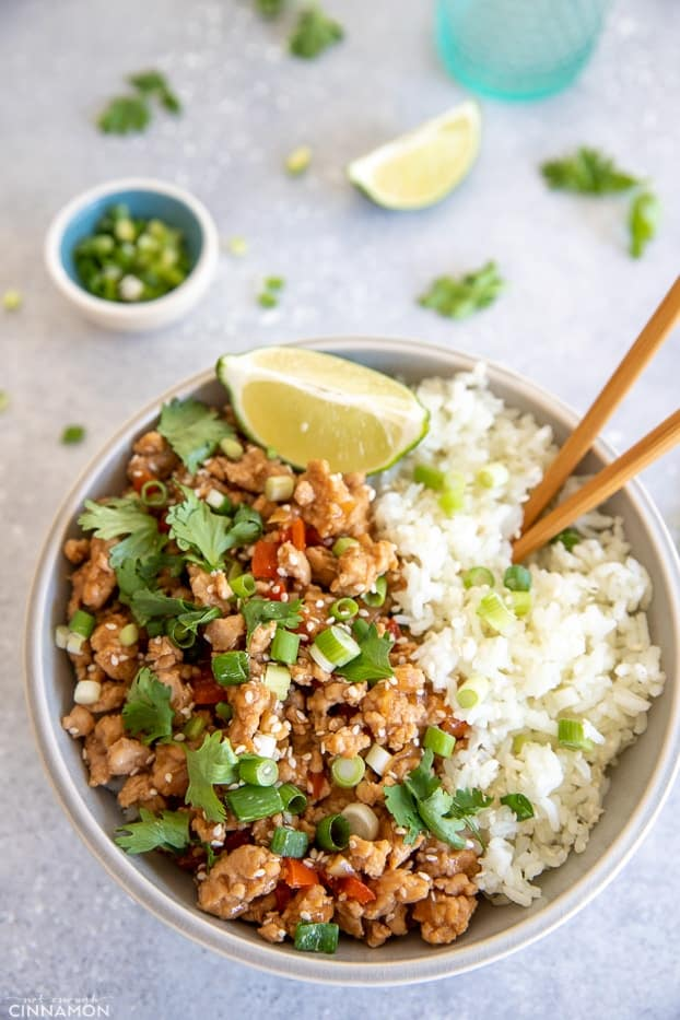 overhead shot of Asian Ground Turkey Rice Bowl with chopsticks stuck into the rice