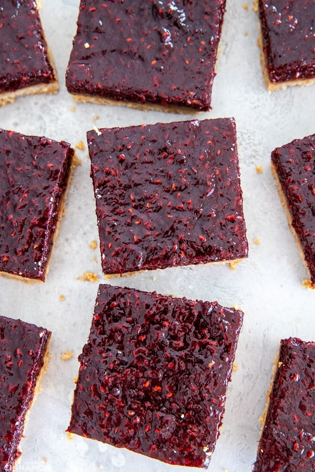 overhead shot of paleo raspberry almond butter bars cut into neat squares