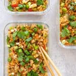 overhead shot of three glass containers with Asian Turkey Fried Rice