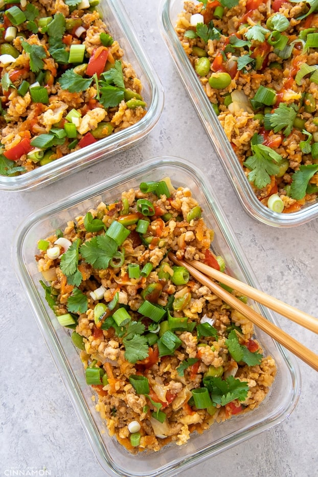 overhead shot of three meal prep containers with Asian Healthy Fried Rice with ground turkey