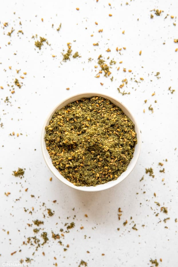 overhead shot of a small white dish with homemade za'atar spice blend