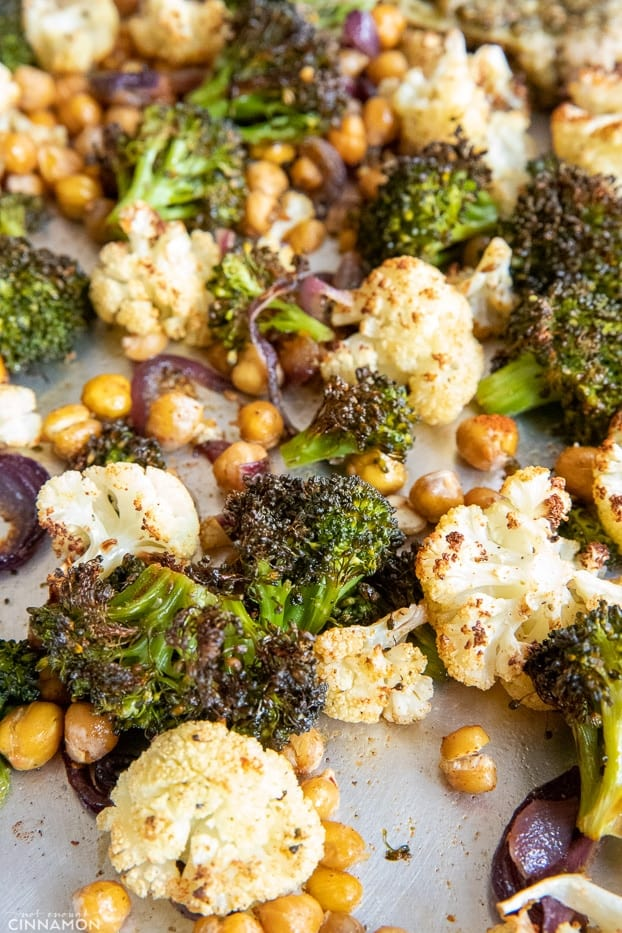 broccoli, cauliflower and chickpeas roasted until crispy and charred on a baking sheet