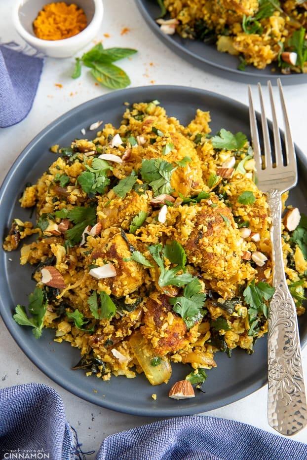 overhead shot of a plate with healthy paleo chicken biryani cauliflower rice stir-fry