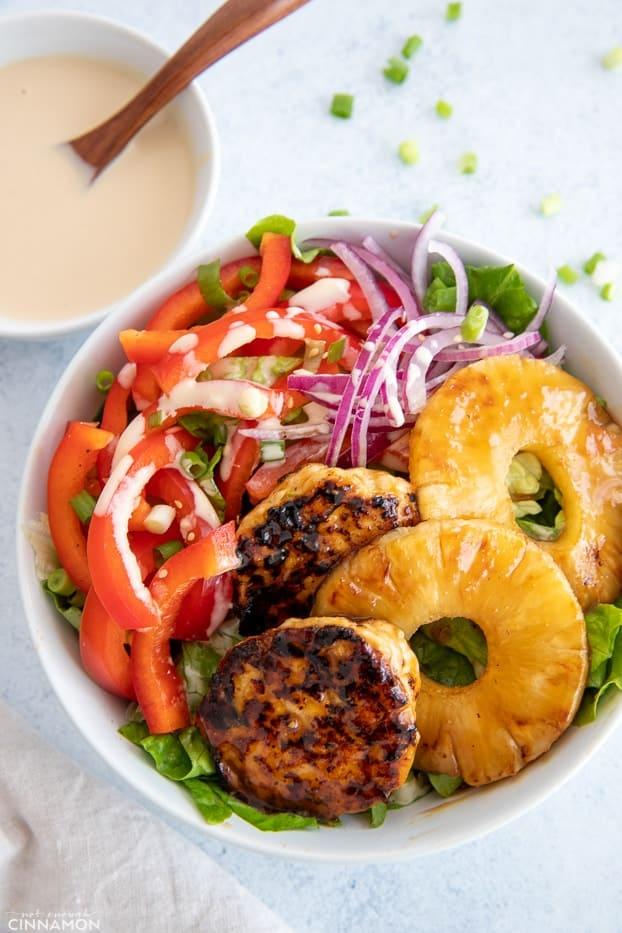 overhead shot of a healthy Hawaiian Chicken Burger Bowl drizzled with Whole30 teriyaki sauce