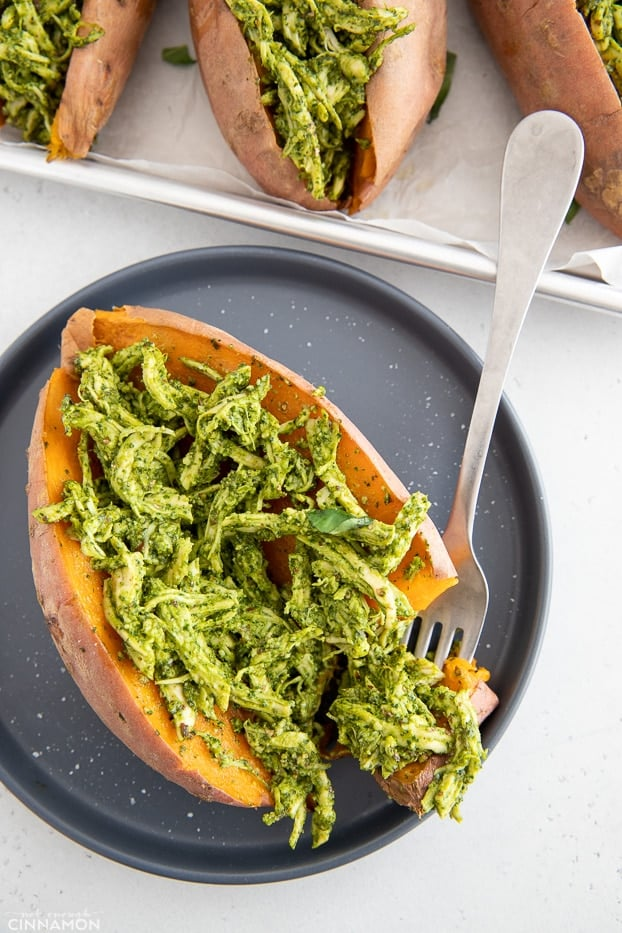 overhead shot of a stuffed sweet potato filled with pesto chicken