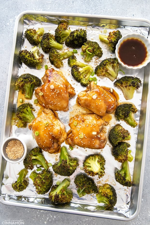 overhead shot of an Asian chicken sheet pan dinner consisting of teriyaki chicken thighs and charred broccoli