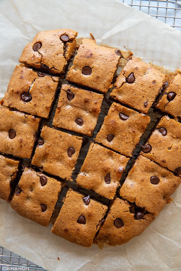 overhead shot of paleo almond butter blondies with chocolate chips cut into squares