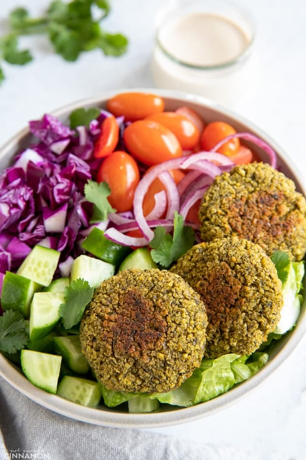 overhead shot of a healthy falafel bowl with three baked falafel