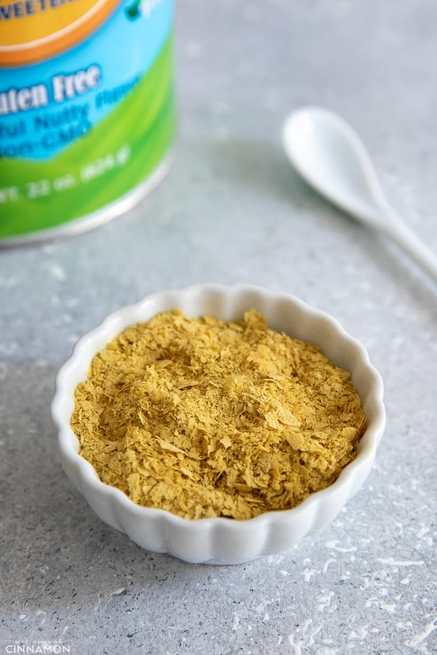 nutritional yeast flakes in a small white dish