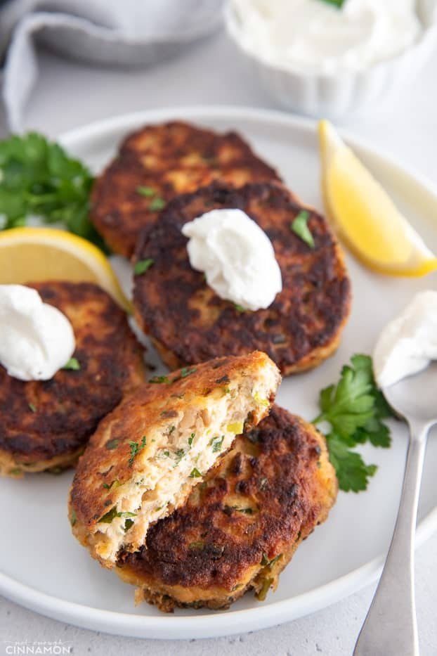 a gluten-free healthy paleo salmon cake being broken into two halves