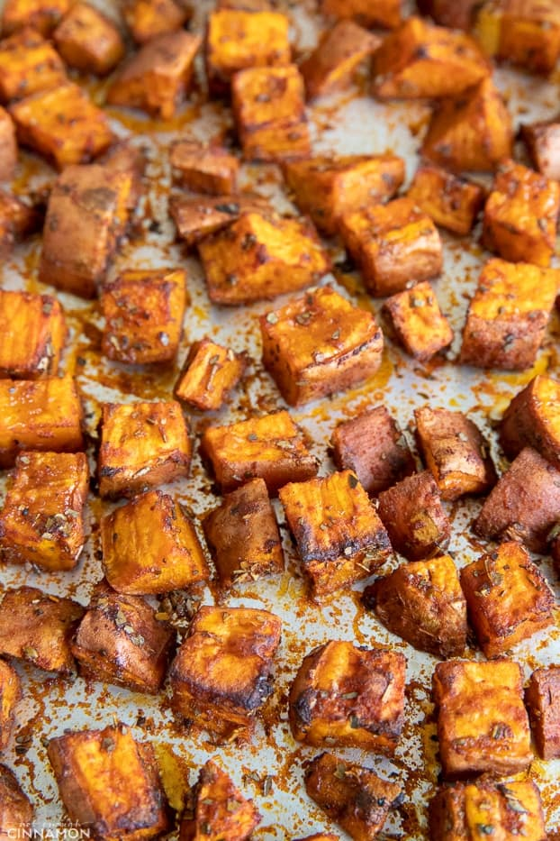 sweet potato cubes roasting on a sheet pan