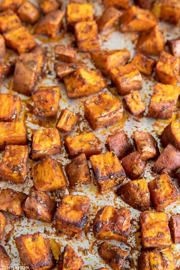 roasted sweet potato cubes on a sheet pan