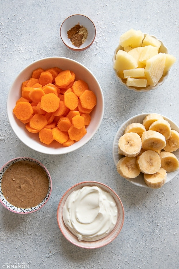 overhead shot of ingredients needed for making carrot cake smoothie