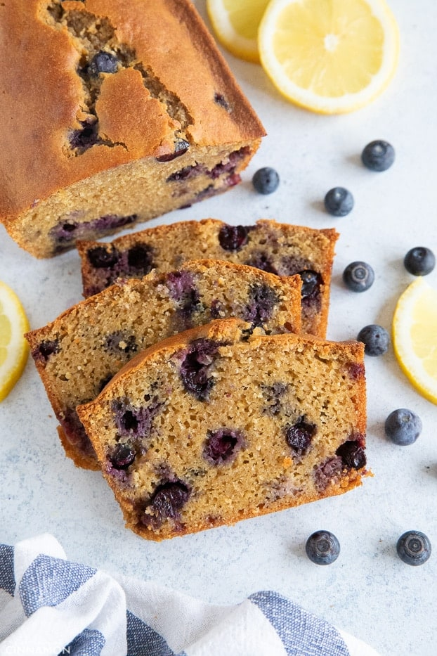 overhead shot of a sliced lemon blueberry bread made with almond and coconut flour