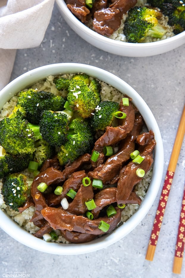 overhead shot of paleo slow cooker Mongolian Beef and Broccoli served over cauliflower rice