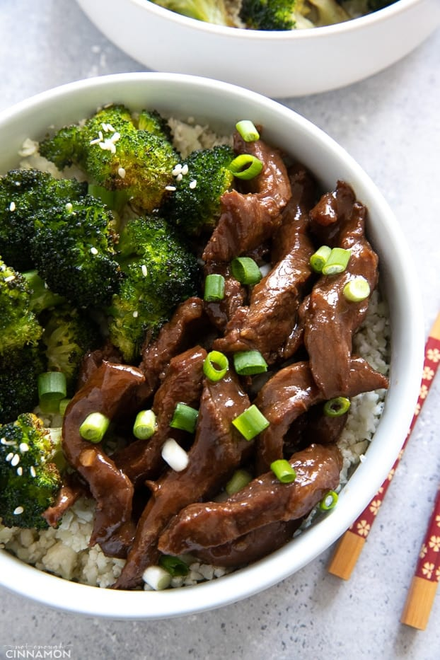 close-up of a bowl of healthy Slow Cooker Mongolian Beef and Broccoli served over low carb cauliflower rice