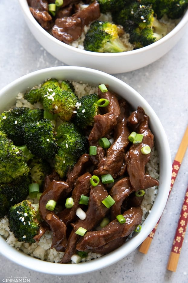 Pf Changs Paleo Mongolian beef served with roasted broccoli with chopsticks on the side