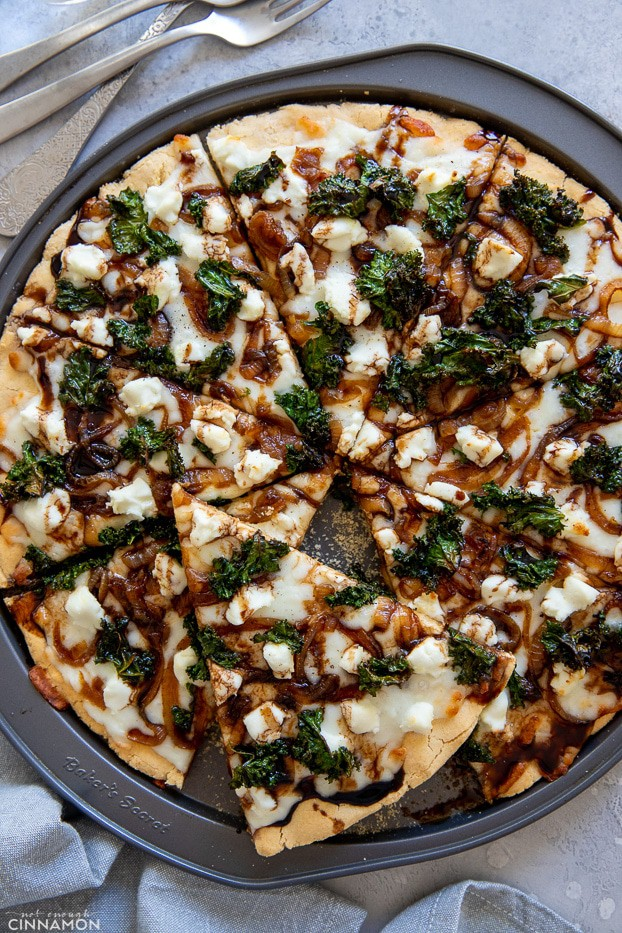 overhead shot of gluten-free pizza topped with goat cheese, caramelized goat cheese and caramelized onions