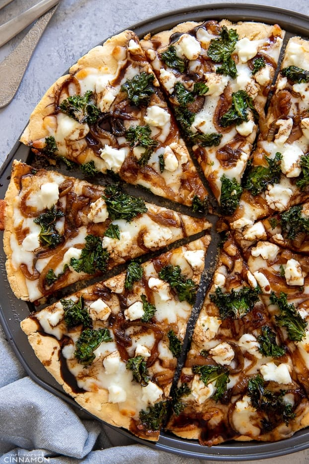 Caramelized Onion Goat Cheese And Kale Pizza With Balsamic Drizzle