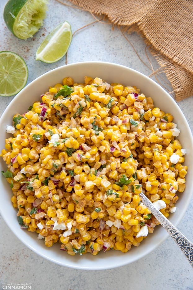 overhead shot of a bowl of healthy Mexican Street Corn Salad tossed with creamy Greek yogurt dressing