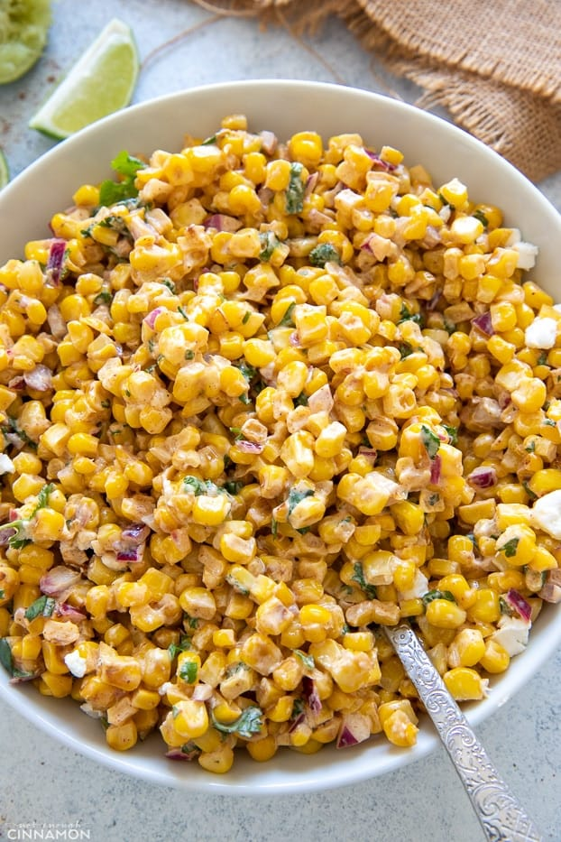 overhead shot of a bowl of Mexican Street Corn Salad with creamy cotija Greek Yogurt dressing