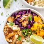 overhead shot of a healthy whole30 paleo fish taco bowl with cilantro lime cauliflower rice