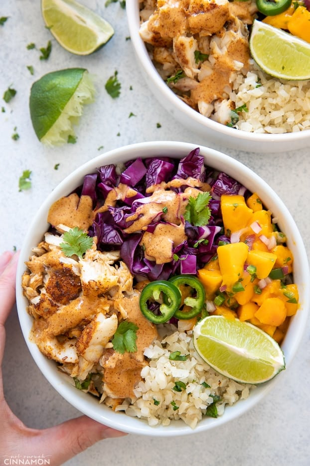 overhead shot of a paleo whole30 fish taco bowl drizzled with chipotle mayo
