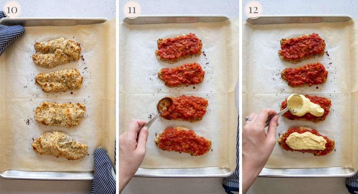 healthy chicken parmesan being baked on a sheet pan and coated with Marinara and cashew cheese sauce