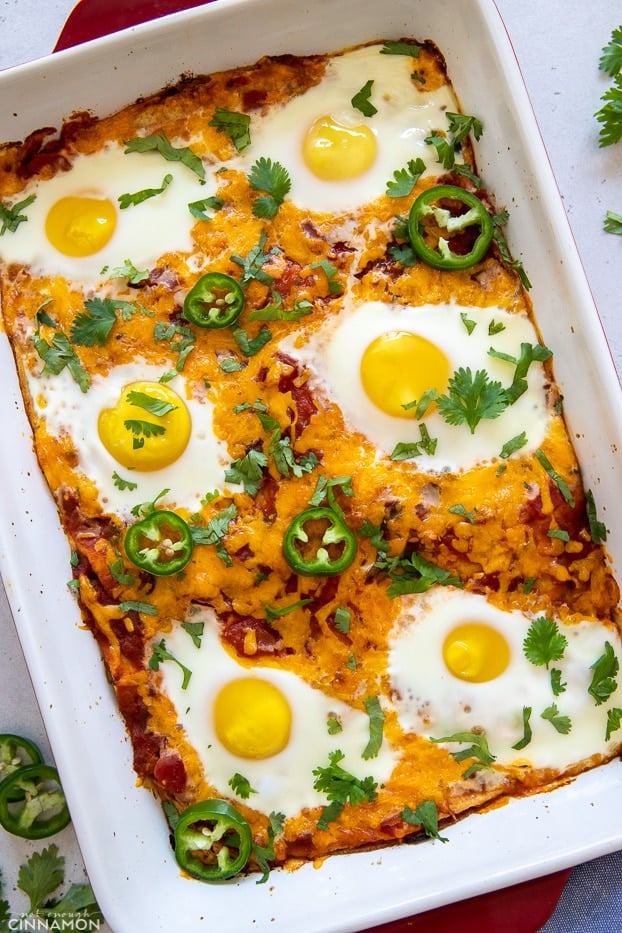 Overhead shot of a healthy Mexican breakfast casserole with eggs, beans and salsa