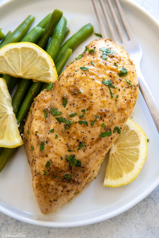 easy baked lemon pepper chicken breast served with a side of green beans